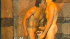 Muscled black stud gets his dick sucked and his ass fucked by a Latino