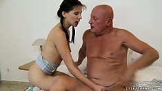 Naughty young brunette in pigtails sucks and fucks bald old man