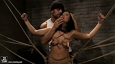 Brunette slave lets out muffled sounds of both pain and pleasure