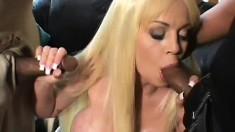 Buxom blonde cougar has two black studs banging her holes in front of her husband