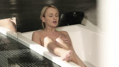 Exciting blonde lets her imagination control her moves in the bathtub