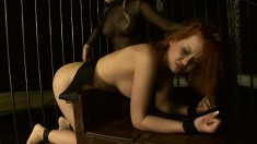 Redhead Valerie is the slave of the day and strung up to be fisted