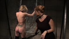 Bodacious blonde in black fishnets gets punished by a hot dominatrix