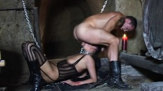 The dark dungeon is the place for wild and weird sex with slaves
