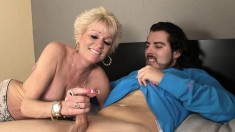 Seductive Blonde Cougar Treats A Younger Stud's Boner To A Handjob And A Blowjob