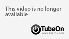 Submissive stud in a black corset bends over for a whipping from hot blonde domme