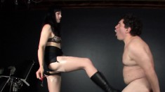 Tubby slave gets his ass whupped and cock tortured by a brunette domme
