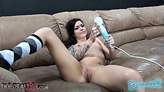 Distinctive brunette with lovely tits Karmen Karma lies on the couch pleasing herself