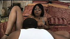 Black babe gives her hung man a wonderful blowjob before sex