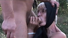 Granny gets down and dirty on the dirty ground in the forest