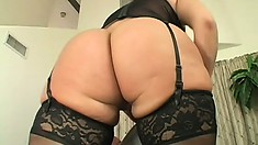 The stacked cougar with a big round booty sucks his cock and tongues his anal hole