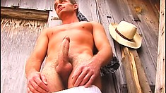 Well-endowed young cowboy strips and shows you his fantastic body and huge cock