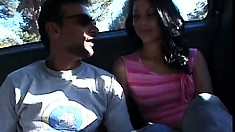 Naughty teens eat cock and pussy in a threesome in the backseat
