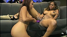 Freaky lesbian bitches make out with each other and use a dildo