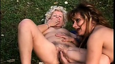 A couple of old broads are outside eating pussy and masturbating together