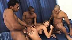 Beautiful blonde has three black guys filling her holes with their load