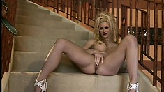 Stacked blonde with sexy long legs welcomes a huge stick up her ass