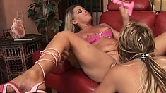 Milf lesbians use their big pink dildo to fuck their pussy and asses