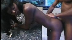 Huge condom-clad cock slides all the way into her chocolate ass