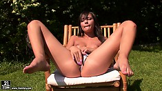 Sexy brunette babe is outdoors sharing some private moments with her puss