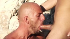 With the sun kissing their bodies, Stelio Colt and Gio Pilou have sex