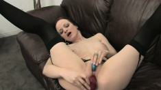 Pale brunette with big natural curves pleasures herself on the couch