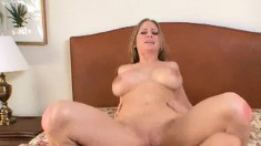 Voluptuous blonde milf Abby Rode has a wild affair with a young stud