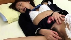 Exciting Asian girl drives her hairy snatch to climax with a sex toy
