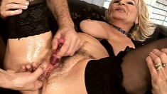 Busty mature in black stockings Sally is longing for intense pleasure