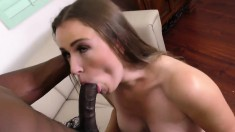 Sexy slender European girl has a black stud stretching her sweet cunt