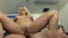 Big breasted blonde mom takes a young man's pole for an exciting ride