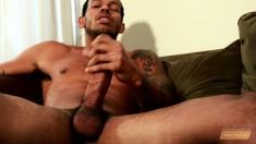 Tattooed black hunk Mike Mann sends his hands pleasing his huge dick