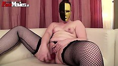 Woman in strange mask and back stockings Claudia does lone masturbation