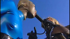 Nice busty blonde Brianna is being washed by a girl in latex outfit