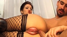 Redhead Liisa in lingerie and sucking two cocks