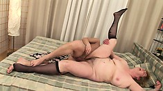 This blonde mature babe with huge tits, a big ass and a hairy cunt is one horny lady