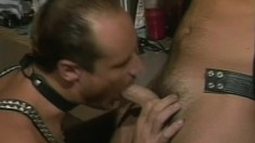 Dirty male in black leather outfit suckles the chap's long shaft
