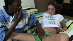 Cute young girl with pigtails gets fucked by a big black rod on the bed